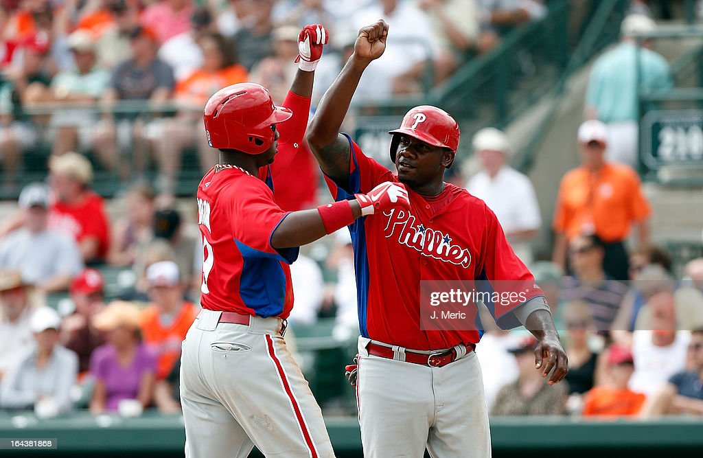 First baseman <a gi-track='captionPersonalityLinkClicked' href=/galleries/search?phrase=Ryan+Howard&family=editorial&specificpeople=551402 ng-click='$event.stopPropagation()'>Ryan Howard</a> #6 of the Philadelphia Phillies congratulates teammate Domonic Brown #9 after his home run against the Baltimore Orioles during a Grapefruit League Spring Training Game at Ed Smith Stadium on March 23, 2013 in Sarasota, Florida.