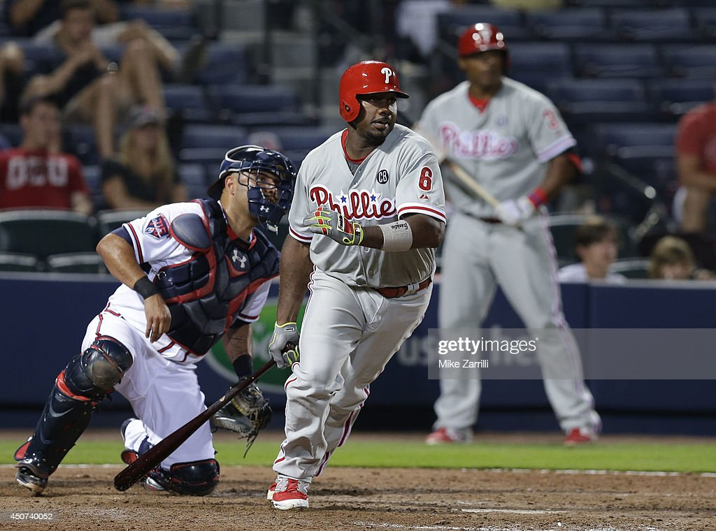 First baseman Ryan Howard #6 of the Philadelphia Phillies hits in the go-ahead run while catcher Gerald Laird #11 of the Atlanta Braves and Marlon Byrd #3 (right) look on during the game at Turner Field on June 16, 2014 in Atlanta, Georgia.