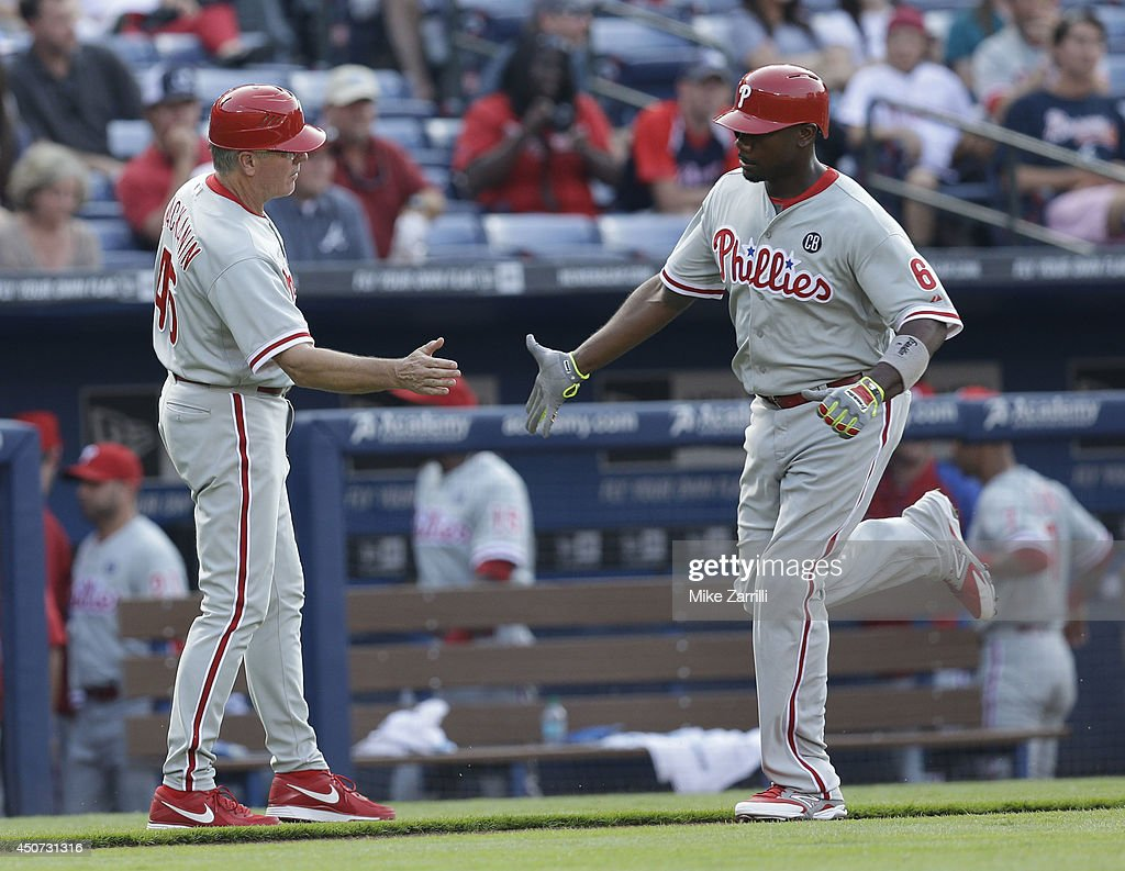 First baseman Ryan Howard #6 of the Philadelphia Phillies is congratulated by third base coach Pete Mackanin #45 after Howard's second inning home run during the game at Turner Field on June 16, 2014 in Atlanta, Georgia.
