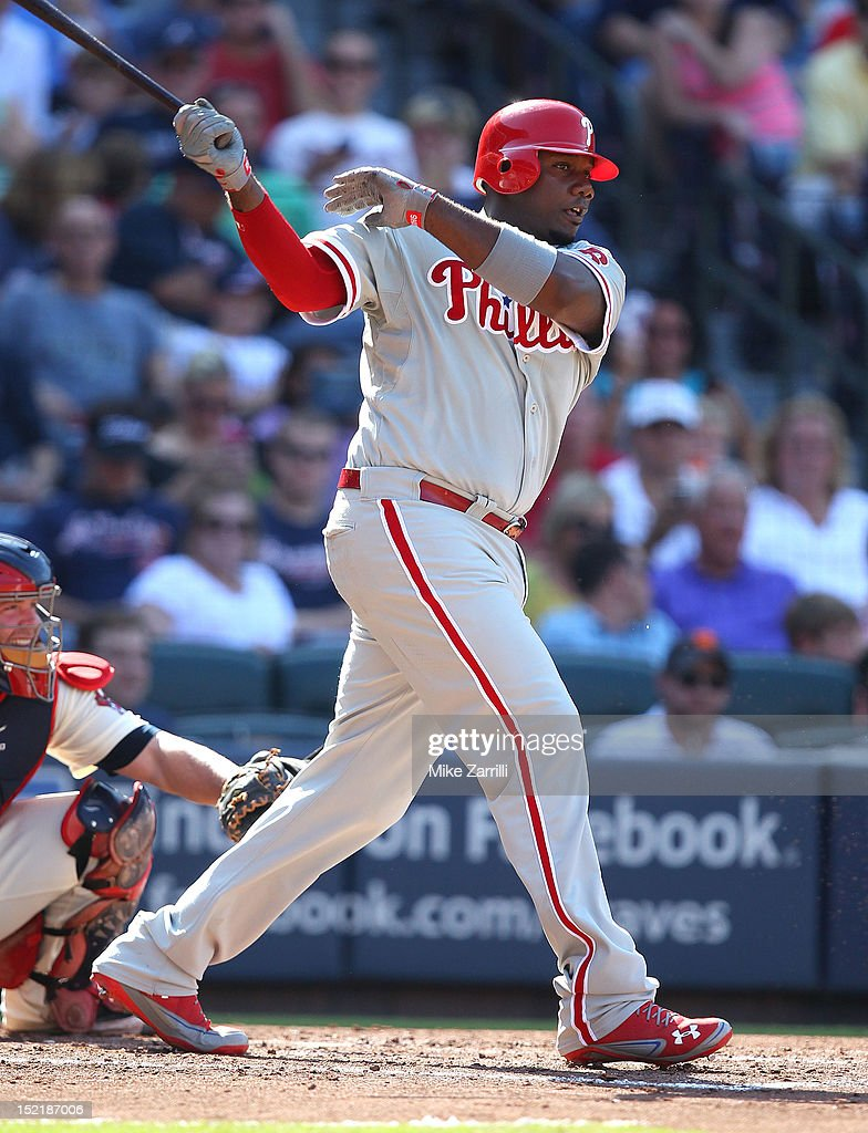 First baseman <a gi-track='captionPersonalityLinkClicked' href=/galleries/search?phrase=Ryan+Howard&family=editorial&specificpeople=551402 ng-click='$event.stopPropagation()'>Ryan Howard</a> #6 of the Philadelphia Phillies swings during the game against the Atlanta Braves at Turner Field on September 1, 2012 in Atlanta, Georgia.
