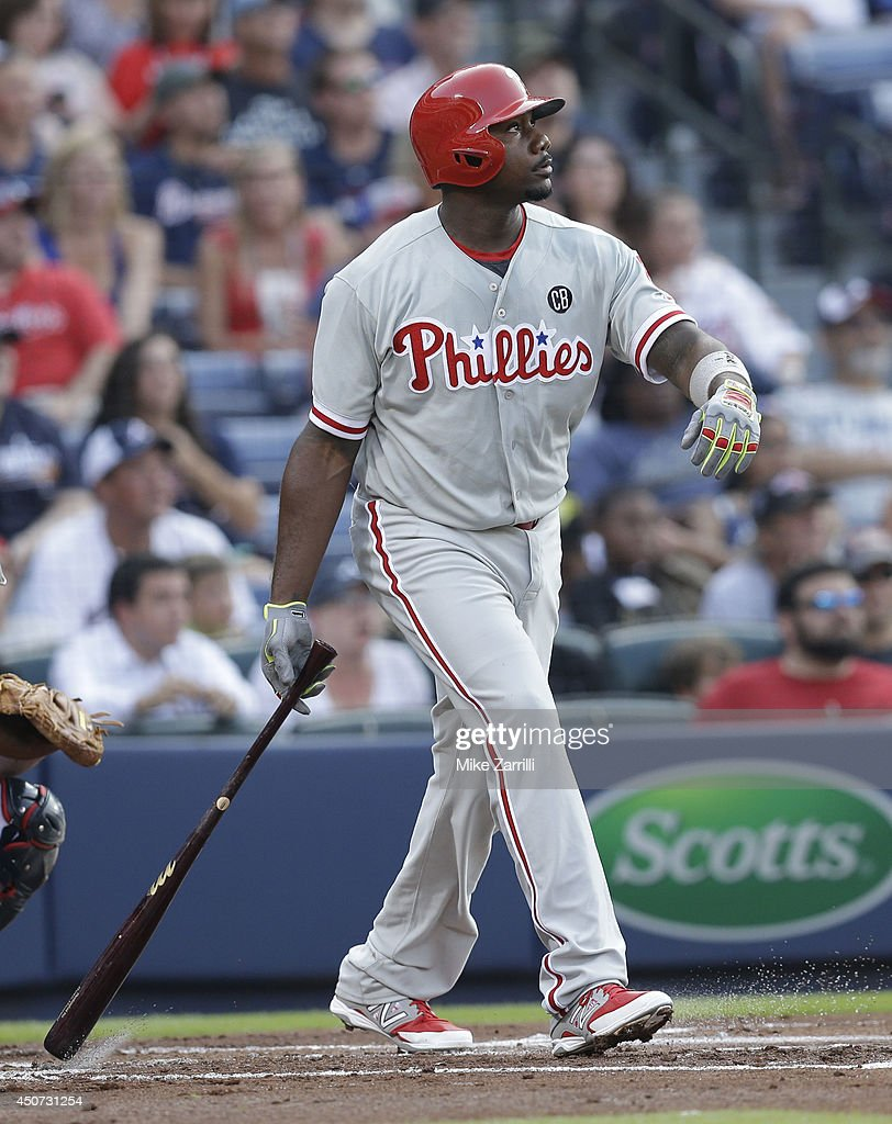 First baseman Ryan Howard #6 of the Philadelphia Phillies watches the ball after connecting for a second inning solo home run during the game against the Atlanta Braves at Turner Field on June 16, 2014 in Atlanta, Georgia.