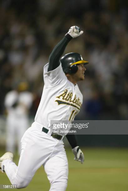 First baseman Scott Hatteberg of the Oakland A's celebrates as he runs the bases during the game against the Kansas City Royals at the Network...
