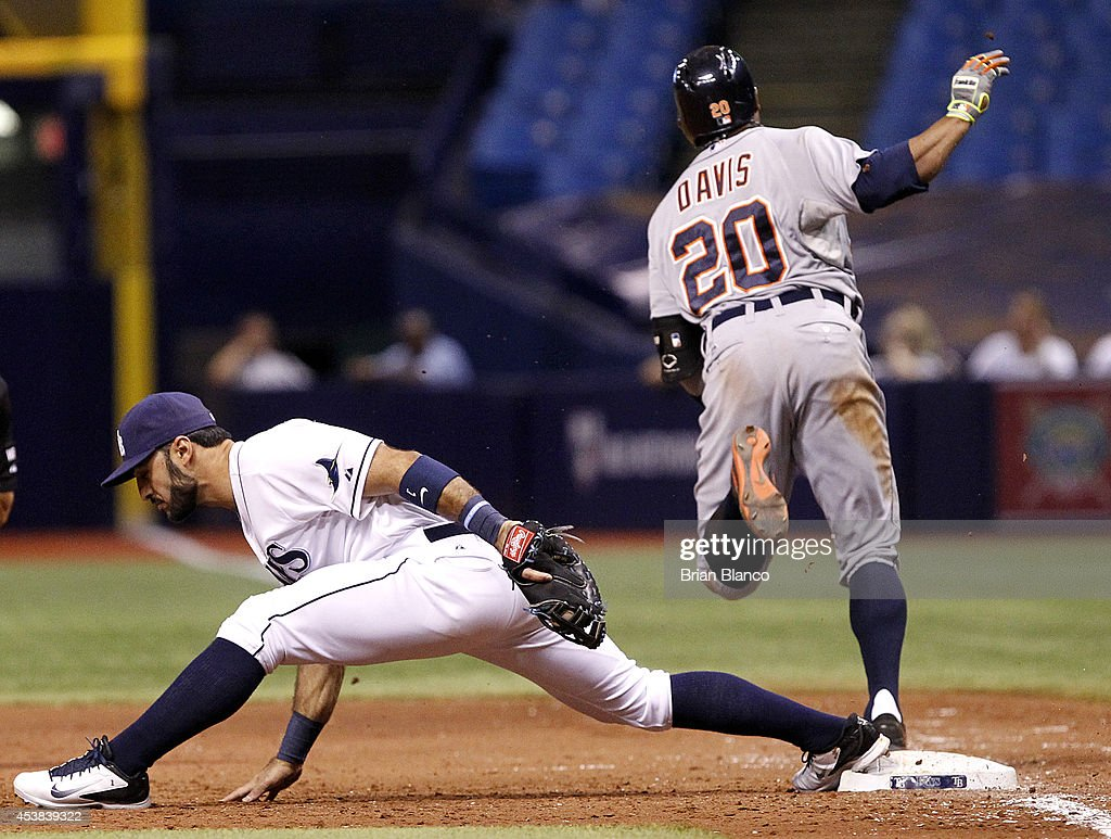First baseman <a gi-track='captionPersonalityLinkClicked' href=/galleries/search?phrase=Sean+Rodriguez&family=editorial&specificpeople=4171805 ng-click='$event.stopPropagation()'>Sean Rodriguez</a> #1 of the Tampa Bay Rays stretches to get the out on <a gi-track='captionPersonalityLinkClicked' href=/galleries/search?phrase=Rajai+Davis&family=editorial&specificpeople=810608 ng-click='$event.stopPropagation()'>Rajai Davis</a> #20 of the Detroit Tigers at first base during the ninth inning of a game on August 19, 2014 at Tropicana Field in St. Petersburg, Florida.