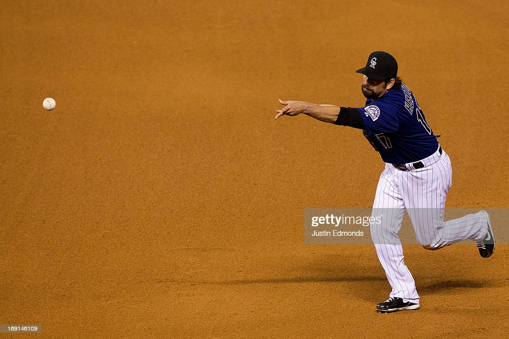 First baseman <a gi-track='captionPersonalityLinkClicked' href=/galleries/search?phrase=Todd+Helton&family=editorial&specificpeople=200735 ng-click='$event.stopPropagation()'>Todd Helton</a> #17 of the Colorado Rockies tosses the ball to the pitcher to record the second out of the eighth inning against the Arizona Diamondbacks at Coors Field on May 20, 2013 in Denver, Colorado. The Diamondbacks defeated the Rockies 5-1.