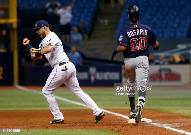 First baseman Trevor Plouffe of the Tampa Bay Rays reacts after completing the double play at first base on Eddie Rosario of the Minnesota Twins to...