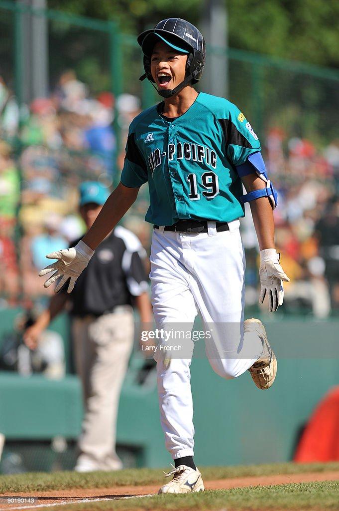 First baseman Wen Hua Sung #19 of Asia Pacific (Taoyuan, Taiwan) scores a run against California (Chula Vista) in the little league world series final at Lamade Stadium on August 30, 2009 in Williamsport, Pennsylvania.