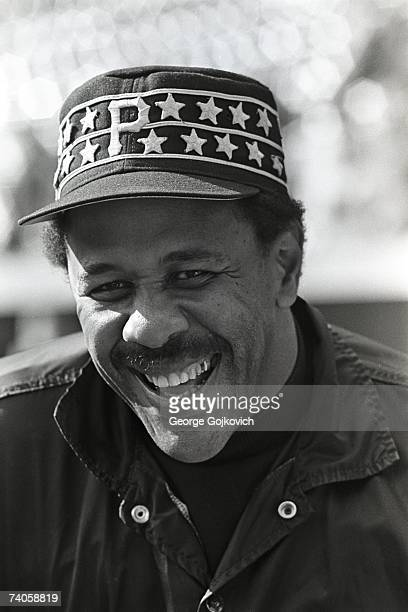 First baseman Willie Stargell of the Pittsburgh Pirates smiles while talking with teammates during batting practice before a Major League Baseball...