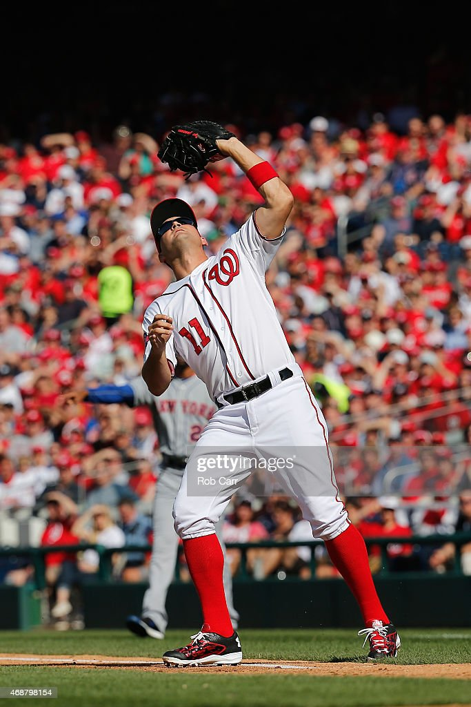 First baseman Wilmer Difo #1 of the Washington Nationals catches a pop up against the New York Mets during Opening Day at Nationals Park on April 6, 2015 in Washington, DC.
