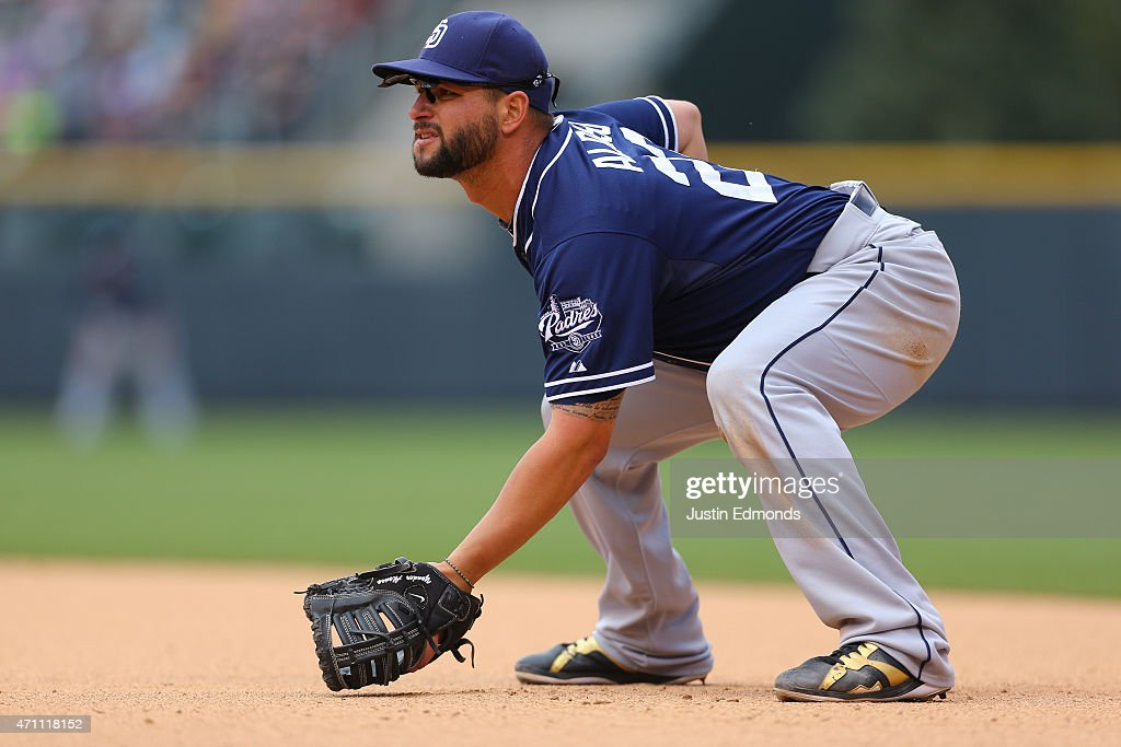 First baseman Yonder Alonso of the San Diego Padres plays defense against the Colorado Rockies at Coors Field on April 23 2015 in Denver Colorado The...