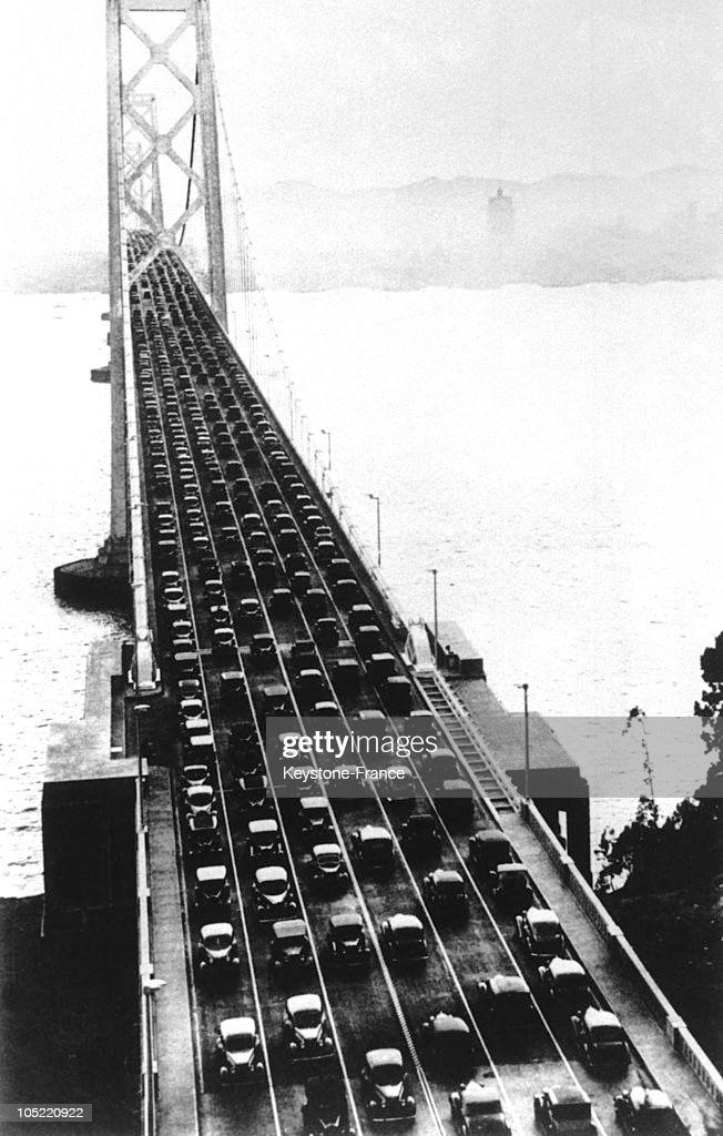 First Cars Driving On Golden Gate On The Inauguration, San Francisco In 1936.