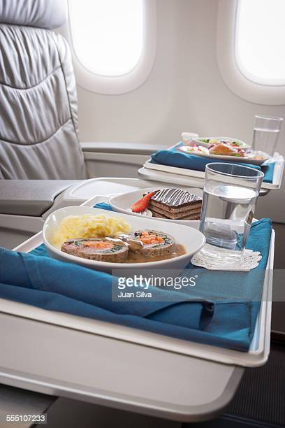 First class airline meal served on seats