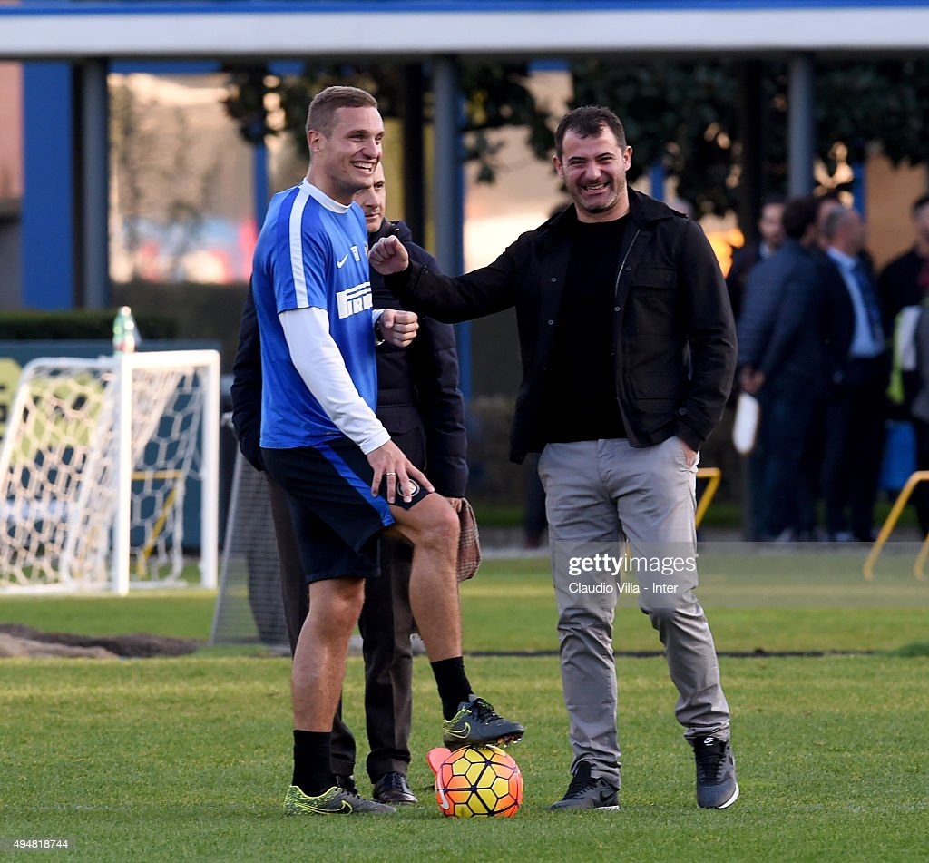 First Club Manager Dejan Stankovic and Nemanja Vidic (L) smile during a FC Internazionale training session at the club's training ground at Appiano Gentile on October 29, 2015 in Como, Italy.