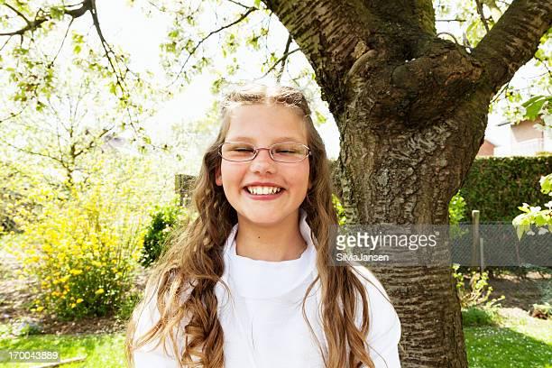 first communion girl in garden