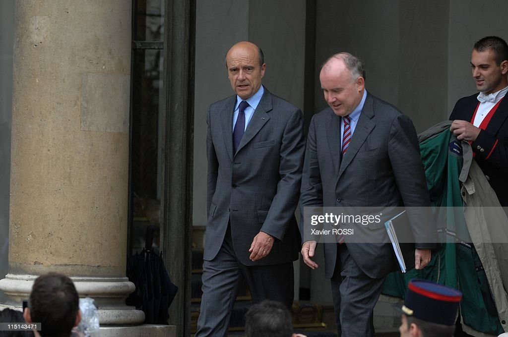 First council of ministers in the new government of Nicolas Sarkozy in Paris, France on May 18, 2007 - <a gi-track='captionPersonalityLinkClicked' href=/galleries/search?phrase=Alain+Juppe&family=editorial&specificpeople=235359 ng-click='$event.stopPropagation()'>Alain Juppe</a> State minister, minister of Ecology of Development and Spatial Planning. On the right M.Bussereau State secretary with State minister.