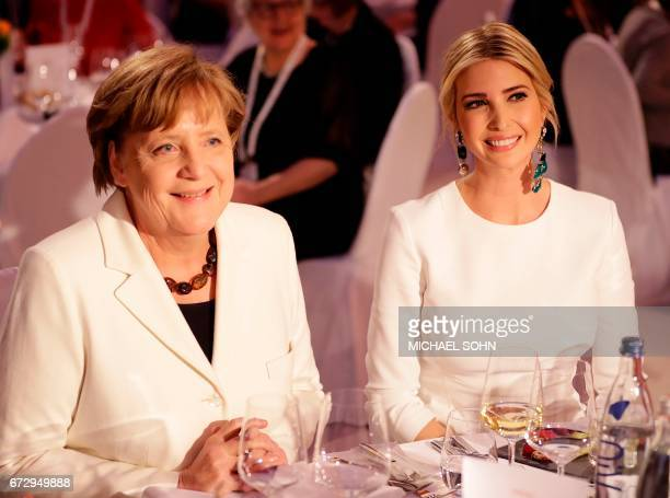First Daughter and Advisor to the US President Ivanka Trump sits next to German Chancellor Angela Merkel during a gala dinner on the sidelines of the...