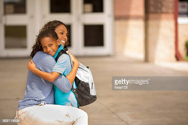 First day of school.  Little boy hugs mom goodbye.