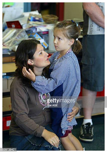 First Day of school May Chynoweth gets a last minute hug from Mum Michelle on her first day at Croydon West Primary School on Tuesday 31st January...