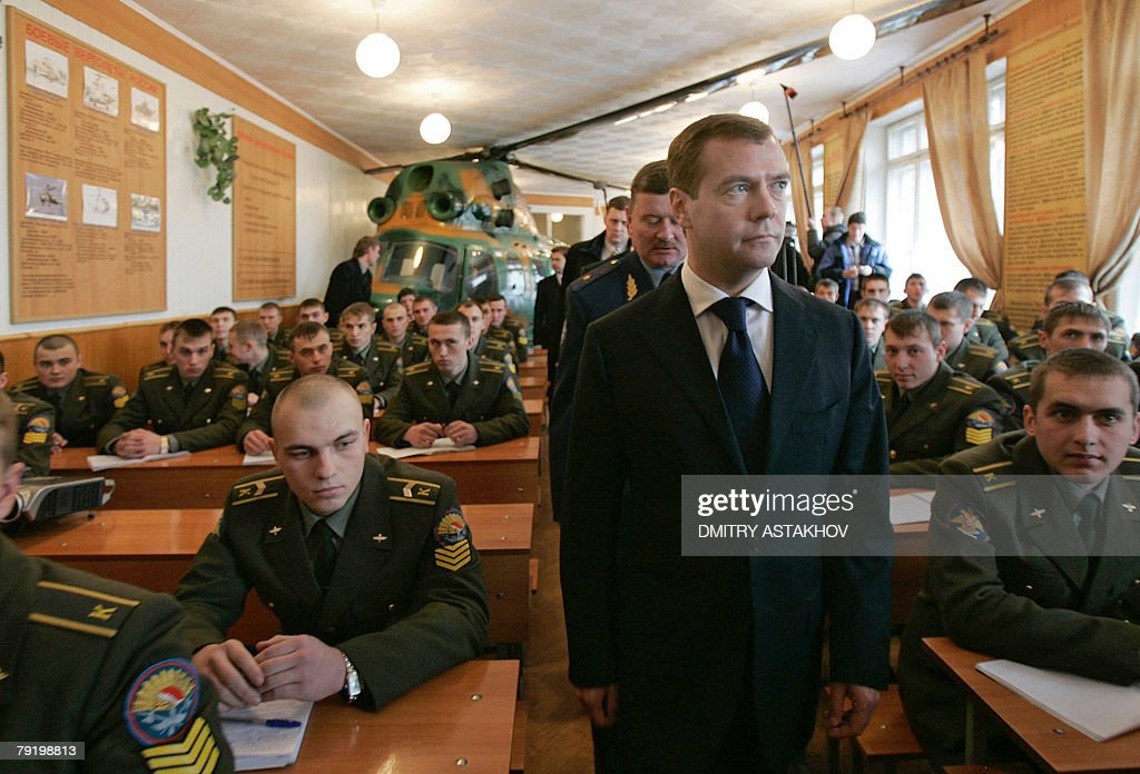 First Deputy Prime Minister and presidential candidate Dmitry Medvedev (C) attends a class studies during his visit to the Higher Military Aircraft Engineering School in Voronezh, 24 January 2008. As the election drew close, Medvedev has traveled across Russian provinces in trips aimed to secure his overwhelming lead by catering to different groups of voters.