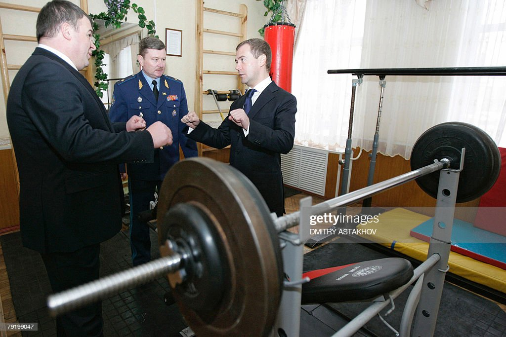 First Deputy Prime Minister and presidential candidate Dmitry Medvedev (R) speaks with Russian Defense Minister Antoly Serdyukov (L) and General Gennady Zibrov, principal of the Higher Military Aircraft Engineering School in Voronezh, 24 January 2008. As the election drew close, Medvedev has traveled across Russian provinces in trips aimed to secure his overwhelming lead by catering to different groups of voters.