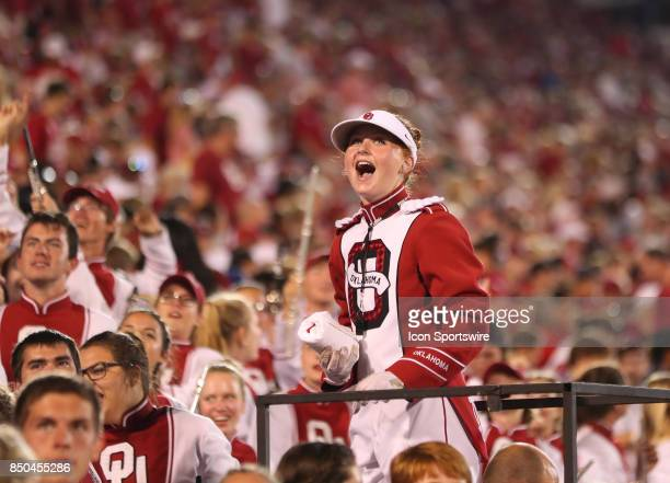 First female drum major at OU Julie Siberts looks at the replay board with excitement after an OU touchdown during a college football game between...