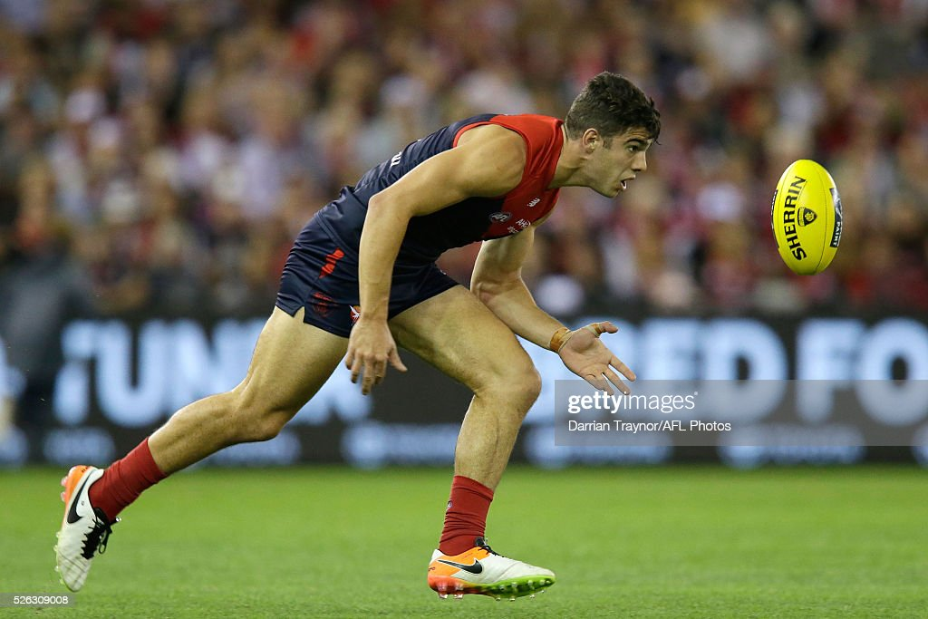 First gamer Christian Petracca of the Demons chases the ball during the round six AFL match between the Melbourne Demons and the St Kilda Saints at Etihad Stadium on April 30, 2016 in Melbourne, Australia.
