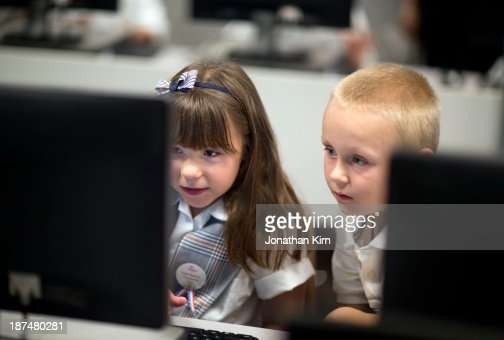 First grade school children learn on computers. : Stock Photo