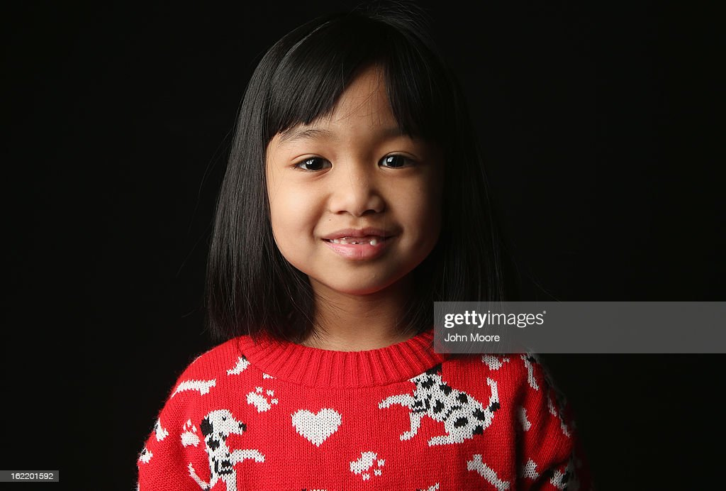 First grader Angelica Kudsi, 7, born in the Philippines, waits for her American citizenship certificate at the U.S. Citizenship and Immigration Services (USCIS), office on February 19, 2013 in New York City. Her mother, a naturalized American citizen, works as a registered nurse, and they live in Yonkers, New York. Almost 300 foreign-born children of naturalized immigrants received citizenship certificates Tuesday at the USCIS center during the special event. Children of naturalized immigrants receive U.S. citizenship if they arrive to the United States as minors, but they must go through a process at USCIS to receive official citizenship documents proving they have become Americans.
