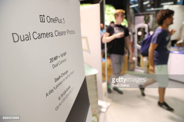 A first group of shoppers arrives to buy the new OnePlus 5 smartphone after waiting in line at a OnePlus popup store at the Bikini Berlin shopping...