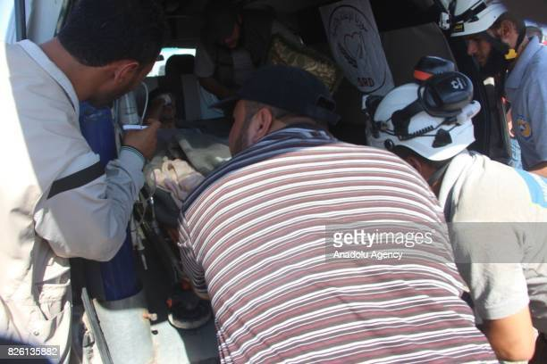 First group of Syrian refugees arrive after a ceasefire announced between Hezbollah and Ahrar alSham in Idlib Syria on August 03 2017 Convoy of...