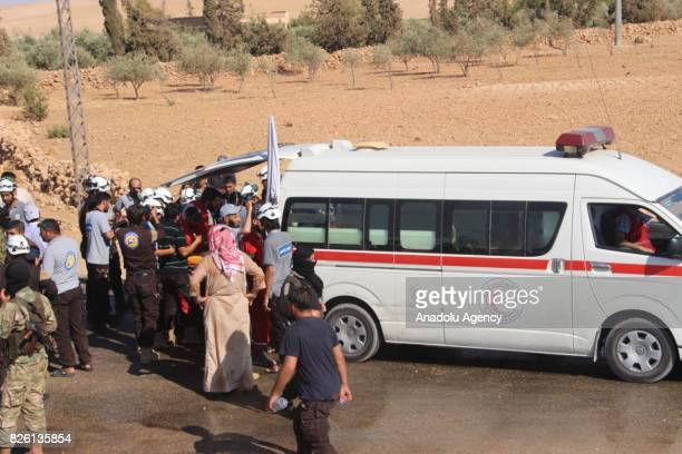 First group of Syrian refugees get off an ambulance after a ceasefire announced between Hezbollah and Ahrar alSham in Idlib Syria on August 03 2017...