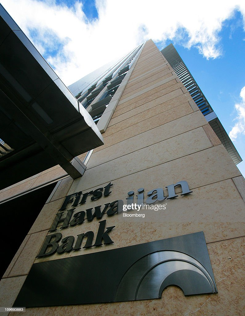 First Hawaiian Bank signage is displayed outside of a branch in Honolulu, Hawaii, U.S., on Wednesday, Jan. 9, 2013. Honolulu, the southernmost major U.S. city, is a major financial center of the islands of the Pacific Ocean. Photographer: Tim Rue/Bloomberg via Getty Images
