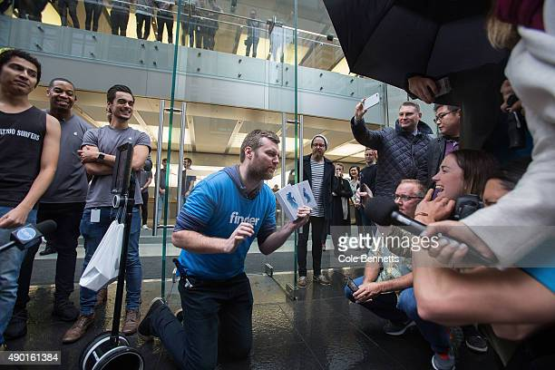 First in line Lindsay Handmer gives an interview after getting his hands on the iPhone 6s Crowds at Apple Store on September 25 2015 in Sydney...
