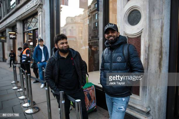 First in line Salam Bin Mohammed from east London who has been queueing since 10pm last night poses for a picture outside Apple Regent Street ahead...