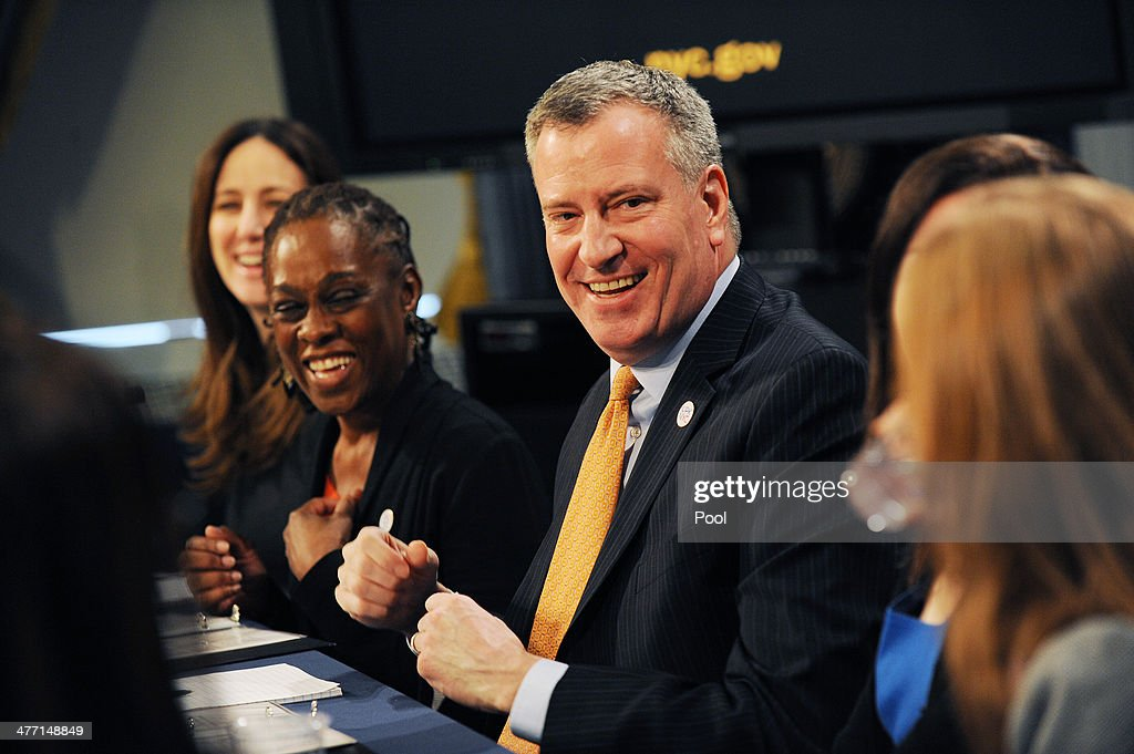 First Lady Chirlane McCray and Mayor Bill de Blasio laugh during a roundtable discussion with parent bloggers in the Blue Room of City Hall on March 7, 2014 in New York City. The roundtable discussion included topics about universal pre-K and after school programs .