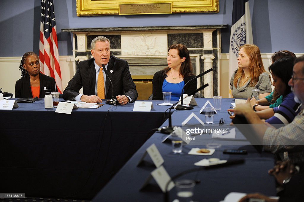 First Lady Chirlane McCray, Mayor Bill de Blasio, Rebecca Levey of KidzVuz and Anna Fader of Mommy Poppins during a roundtable discussion with parent bloggers in the Blue Room of City Hall on March 7, 2014 in New York City. The roundtable discussion included topics about universal pre-K and after school programs .