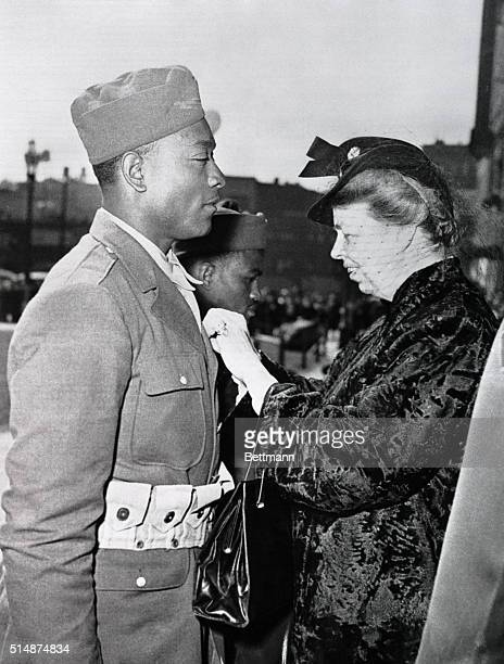 First Lady Eleanor Roosevelt pins the Soldier's Medal on Private Sam Morris at a ceremony in Seattle in April 1943 Morris saved the lives of several...
