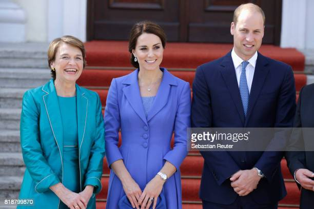 First Lady Elke Buedenbender greets Catherine Duchess of Cambridge and Prince William Duke of Cambridge as they arrive at Bellevue Castle on the...
