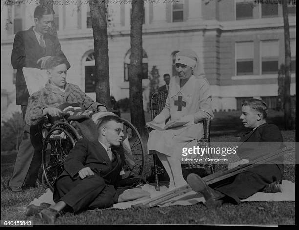 First Lady Grace Goodhue Coolidge reads to disabled veterans on the lawn outside of Walter Reed Army Hospital in Washington DC