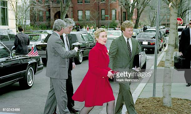 US First Lady Hillary Clinton and President Bill Clinton walk across O Street as they arrive at the First Baptist Church of the City of Washington DC...