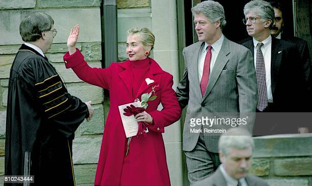 US First Lady Hillary Clinton and President Bill Clinton wave as they leave the First Baptist Church of the City of Washington DC after a service...