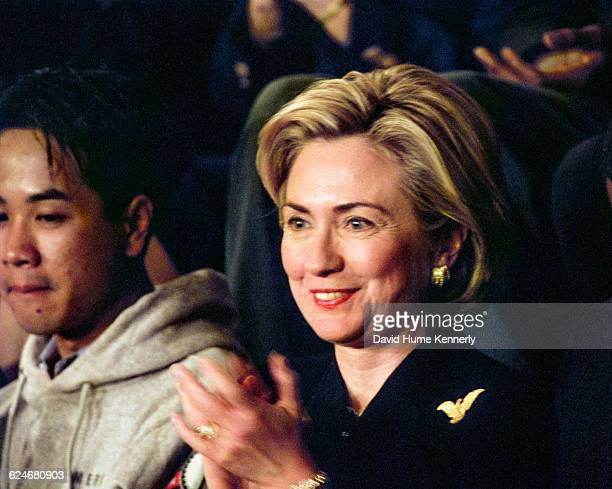 First Lady Hillary Clinton applauds during President Bill Clinton's State of the Union speech before a joint session of Congress on January 20 1999