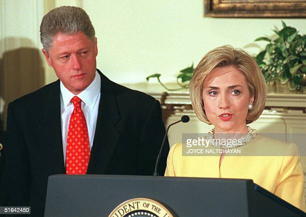First Lady Hillary Clinton delivers a speech promoting education as her husband US President Bill Clinton listens during an announcement 26 January...