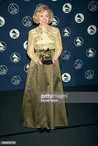 First Lady Hillary Clinton holds the Grammy award she received in the Best Spoken Word or NonMusical Album category for the audio version of her book...