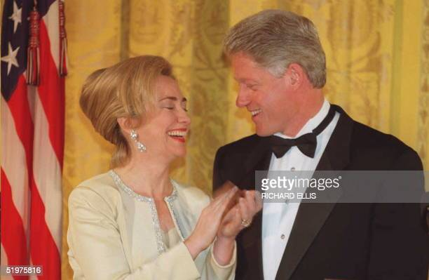 First Lady Hillary Clinton laughs after introducing US President Bill Clinton 27 April in the East Room of the White House in Washington DC The...