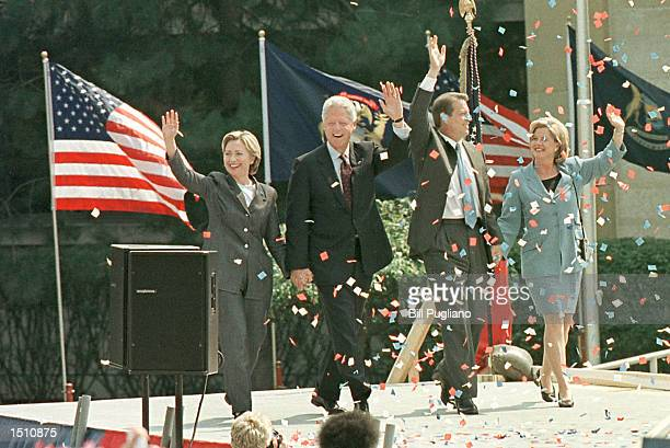 First Lady Hillary Clinton President Bill Clinton Vice President Al Gore and Tipper Gore walk on stage at a rally in Monroe Michigan August 15 2000...