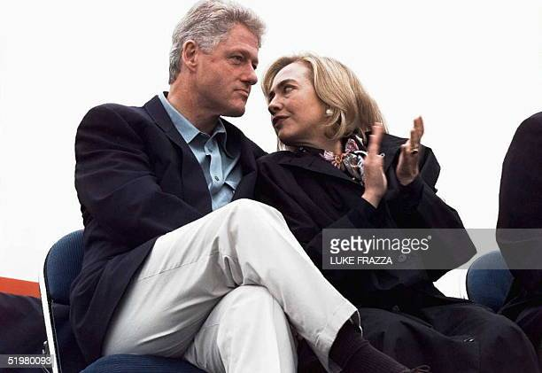 First Lady Hillary Clinton talks to US President Bill Clinton 19 September during a rally in Tacoma Washington The Clintons and Gores are campaigning...