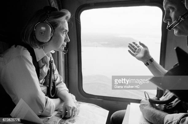 First Lady Hillary Rodham Clinton and Lars Klassen mission director of USAID are photographed in a helicopter enroute to Chica on October 10 1997 in...