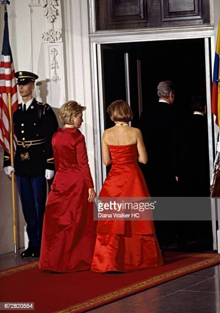 First Lady Hillary Rodham Clinton escorts Nohra Puyana wife of President Andres Pastrana of Colombia through the North Portico of the White House to...