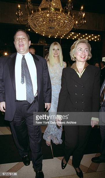 First Lady Hillary Rodham Clinton is joined by actress Gwyneth Paltrow and Harvey Weinstein at the premiere of 'Shakespeare in Love' at the Ziegfeld...