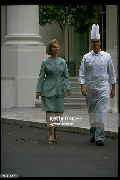 US First Lady Hillary Rodham Clinton strolling with White House chef Walter Scheib during Fruits Vegetables Month event at the White House